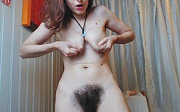 Young nudist open legs